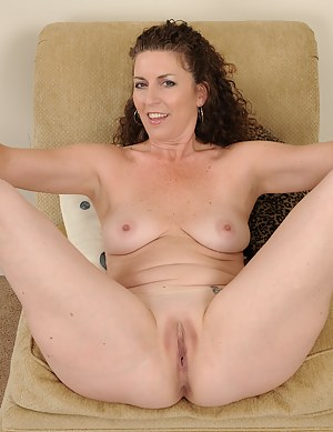 Horny Tammy Sue showing off her 46 year old body and spreading pink