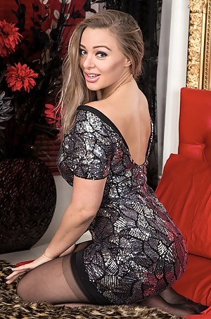 Busty MILF Beth Bennett naked in only black stockings.